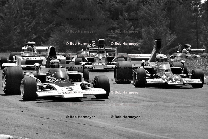 WATKINS GLEN, NY - JULY 14: Mario Andretti in the #5 Vel Miletich Lola T332 HU29/Chevrolet and Brian Redman in the Haas Racing Lola T332 HU42/Chevrolet lead the field on a parade lap before the USAC/SCCA Formula 5000 race at the Watkins Glen Grand Prix Race Course near Watkins Glen, New York, on July 14, 1974. The pair finished the race in first and second places, respectively.
