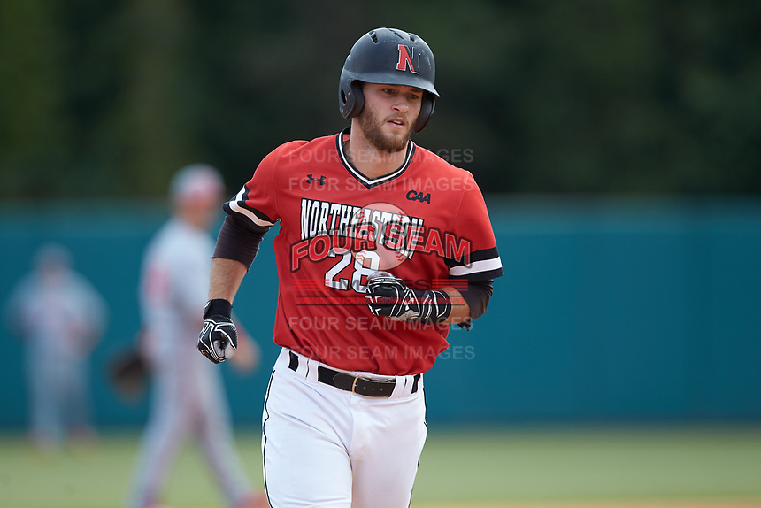 Scott Holzwasser (28) of the Northeastern Huskies rounds the bases after hitting a home run against the North Carolina State Wolfpack at Doak Field at Dail Park on June 2, 2018 in Raleigh, North Carolina. The Wolfpack defeated the Huskies 9-2. (Brian Westerholt/Four Seam Images)