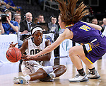 SIOUX FALLS, SD - MARCH 6:  Faith Ihim #15 of Oral Roberts fights for the ball with Michelle Maher #14 of Western Illinois in the 2016 Summit League Tournament. (Photo by Dave Eggen/Inertia)
