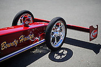 Jul. 17, 2010; Sonoma, CA, USA; The front wing and wheels and tires on the car of NHRA top fuel dragster driver David Grubnic (not pictured) during qualifying for the Fram Autolite Nationals at Infineon Raceway. Mandatory Credit: Mark J. Rebilas-