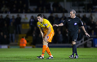 Referee Brandon Malone checks on injured Luke O'Nien of Wycombe Wanderers during the Sky Bet League 2 rearranged match between Bristol Rovers and Wycombe Wanderers at the Memorial Stadium, Bristol, England on 1 December 2015. Photo by Andy Rowland.