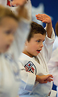 A young boy practices the moves of Songham Taekwondo during a class in taekwando. Photo taken as part of an ATA class in Huntersville, NC.