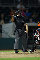 Home plate umpire Josh Gilreath makes a strike call during the during the South Atlantic League game between the Kannapolis Intimidators and the Augusta GreenJackets at SRG Park on July 6, 2019 in North Augusta, South Carolina. The Intimidators defeated the GreenJackets 9-5. (Brian Westerholt/Four Seam Images)