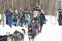 Jeff Deeter and team run past spectators on the bike/ski trail near University Lake with an Iditarider in the basket and a handler during the Anchorage, Alaska ceremonial start on Saturday, March 7 during the 2020 Iditarod race. Photo © 2020 by Ed Bennett/Bennett Images LLC
