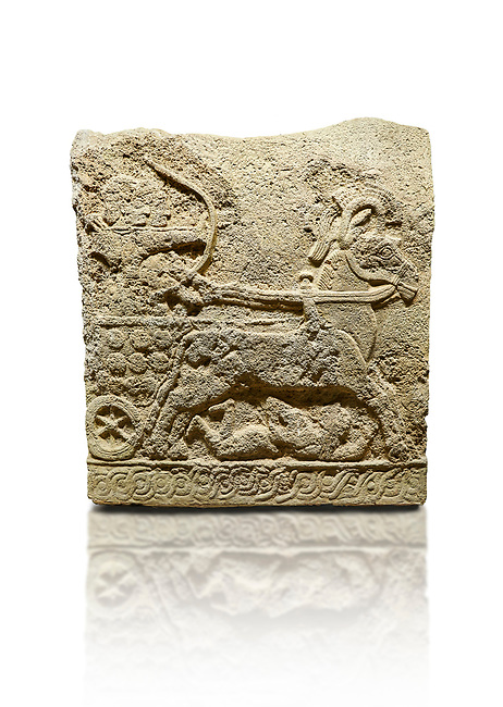 Hittite relief sculpted orthostat stone panel of Long Wall Basalt, Karkamıs, (Kargamıs), Carchemish (Karkemish), 900 - 700 BC. Anatolian Civilizations Museum, Ankara, Turkey.<br /> <br /> Chariot. One of the two figures in the chariot holds the horse's headstall while the other throws arrows. There is a naked enemy with an arrow in his hip lying face down under the horse's feet. It is thought that this figure is depicted smaller than the other figures since it is an enemy soldier. The tower part of the orthostat is decorated with braiding motifs.<br /> <br /> On a White Background.