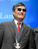 Chen Guangcheng, the blind Chinese legal activist, accepts the Tom Lantos Human Rights Prize in the United States Capitol on January 29, 2013..Credit: Ron Sachs