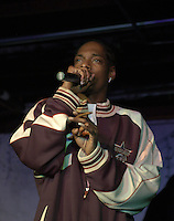 EXCLUSIVE-DO NOT PUBLISH WITH PHOTO CREDIT-NO NAME.Rapper and TV Fizzle Star Snoop Dog smokes a blunt on stage during his performance at Hal & Mal's in Jackson, MS. Monday night Jan.5 2004.(photo/Suzi Altman