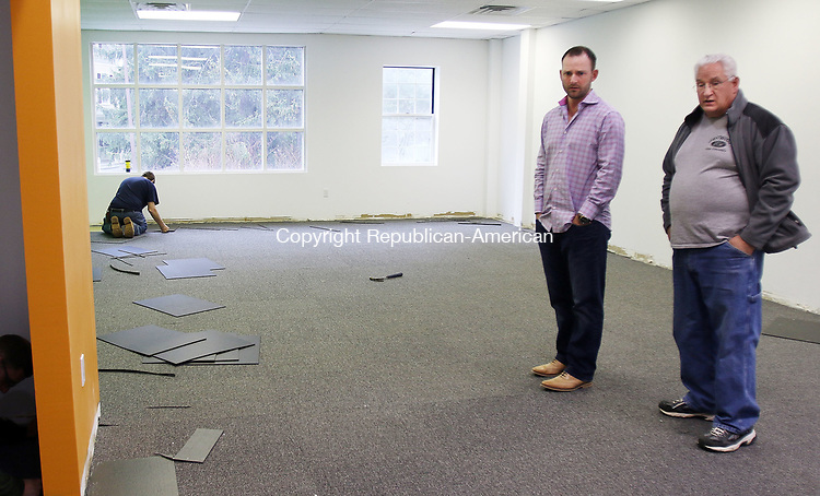 WATERTOWN CT. 09 May 2017-050917SV04-From left, Brandon Dufour, general manager, talks with John Eastwood, owner of Eastwood&rsquo;s Fine Finishes, about his company&rsquo;s new classroom at 680 Main Street in Watertown Tuesday. The Next Street Driving School is expanding to that location.<br /> Steven Valenti Republican-American