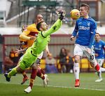 07.04.2019 Motherwell v Rangers: Mark Gillespie punches the ball onto the nose of Steven Davis
