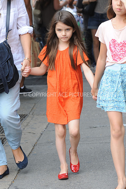 WWW.ACEPIXS.COM . . . . . .July 14, 2012...New York City....Suri Cruise and a friend went to look at puppies at Citipups on July 14, 2012 in New York City. ....Please byline: KRISTIN CALLAHAN - WWW.ACEPIXS.COM.. . . . . . ..Ace Pictures, Inc: ..tel: (212) 243 8787 or (646) 769 0430..e-mail: info@acepixs.com..web: http://www.acepixs.com .