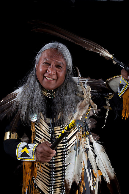 Derald Julianto (Shoshone Paiute) dressed in traditional men's pow wow regalia made of eagle feathers and bone beads.