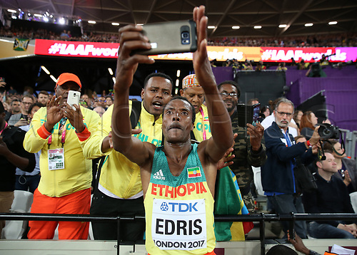 August 12th 2017, London Stadium, East London, England; IAAF World Championships, Day 9; Muktar Edris of Ethiopia celebrates with a selfie behind the Ehiopia fans after finishing 1st place to become World Champion of the 5000 metres men final