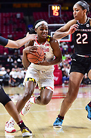 College Park, MD - NOV 13, 2017: Maryland Terrapins guard Kaila Charles (5) splits South Carolina Gamecocks defenders A'ja Wilson (22) and Tyasha Harris (52) on her way to the basket during match up between No. 4 ranked South Carolina and the No. 15 Maryland Terrapins at the XFINITY Center in College Park, MD. The Gamecocks defeated Maryland 94-86.  (Photo by Phil Peters/Media Images International)