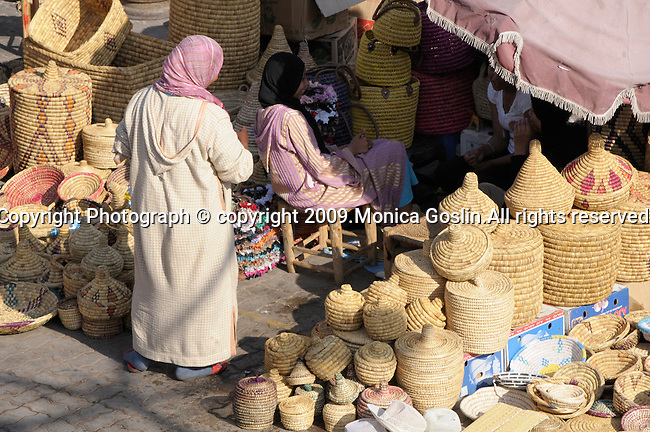 Women selling baskets in the market in Marrakesh, Morocco.