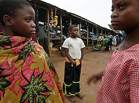 Pygmies without a forest forced into a market economy.  They are not comfortable.