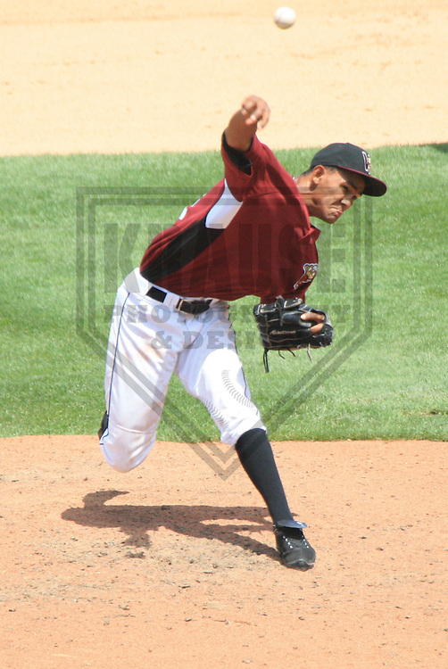 APPLETON - JULY 2010: Adrian Rosario (14) of the Wisconsin Timber Rattlers, Class-A affiliate of the Milwaukee Brewers, during a game on July 12, 2010 at Fox Cities Stadium in Appleton, Wisconsin. (Photo by Brad Krause)