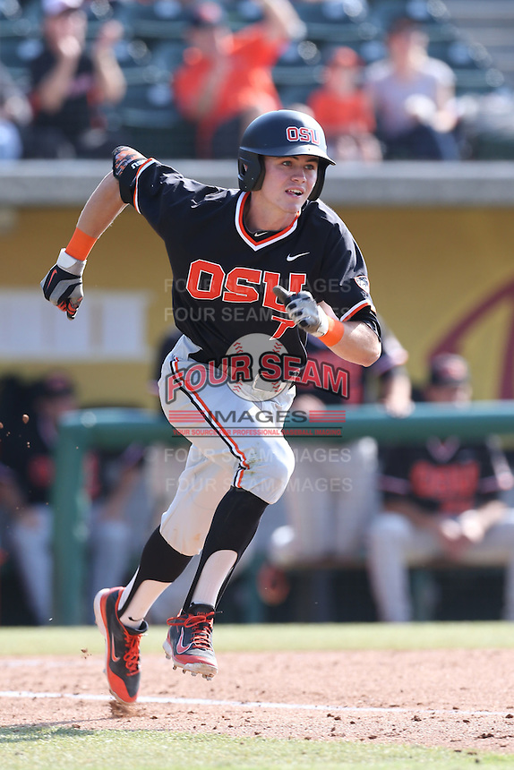 Trever Morrison #7 of the Oregon State Beavers runs to first base during a game against the Southern California Trojans at Dedeaux Field on May 23, 2014 in Los Angeles, California. Southern California defeated Oregon State, 4-2. (Larry Goren/Four Seam Images)