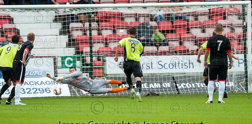 Pars keeper Ryan Scully saves Stranraer's Chris Aitken's (hidden behind pars 7) penalty.