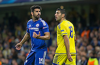 Diego Costa of Chelsea looks to the linesman after taking an off the ball push from Eitan Tibi of Maccabi Tel Aviv during the UEFA Champions League match between Chelsea and Maccabi Tel Aviv at Stamford Bridge, London, England on 16 September 2015. Photo by Andy Rowland.