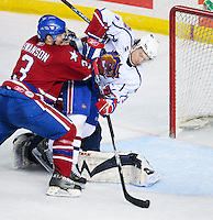 April 28, 2007; Hamilton, ON, CAN; Hamilton Bulldogs centre (31) Mikhail Grabovski tries to get a shot on goal as Rochester Americans defenceman (3) Jeremy Swanson pushes him into goalie (30) Craig Anderson in game six of the AHL north division semifinal at Copps Coliseum. The Bulldogs defeated won 6-2 and eliminated the Americans from the playoffs. Mandatory Credit: Ron Scheffler, Special to the Spectator. (File number RRSA7729).
