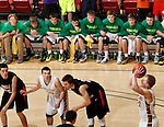 RAPID CITY, S.D.-- MARCH 21, 2015: Players on the Aberdeen Roncalli bench link arms as teammate Brayden McNeary #23 shoots a free throw in the final seconds of the 2015 S.D. State A Boys Basketball Championship against Dell Rapids at the Don Barnett Arena in Rapid City Saturday. (Photo by Dick Carlson/Inertia)