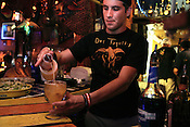 May 30, 2009. Raleigh, NC..Bartender Taylor Harris creates the signature House Margarita for which Dos Toquitos is known.