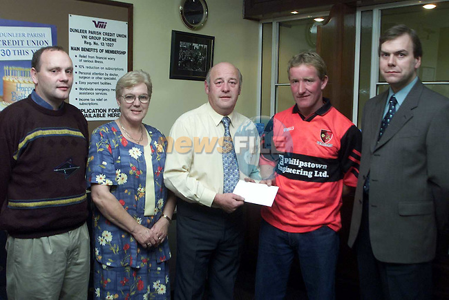 Frank Keaskin, chairman board Dunller Credit Union presenting a cheque to Joe Matthews, captain St. Kevins GFC. Also pictured are David Rogers, chairman St. Kevins, sarah stokes, board directors Dunleer Credit Union and Thomas Fitzpatrick, manager Dunleer Credit Union..Picture: Paul Mohan Newsfile