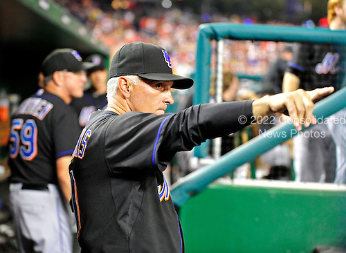 New York Mets manager Terry Collins (10) directs his team in the top of the ninth inning against the Washington Nationals at Nationals Park in Washington, D.C. on Saturday, July 30, 2011.  The Mets loaded the bases but could not score.  The Nationals won the game 3 - 0..Credit: Ron Sachs / CNP.(RESTRICTION: NO New York or New Jersey Newspapers or newspapers within a 75 mile radius of New York City)