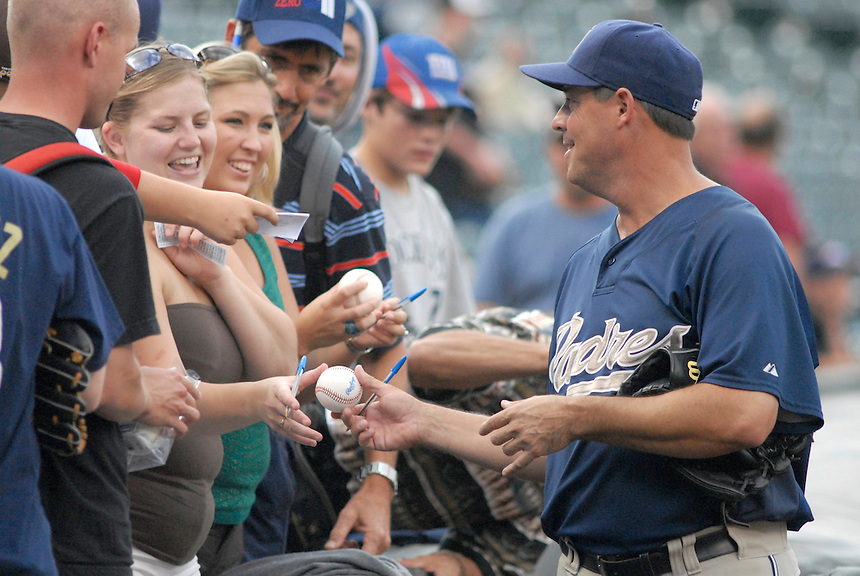 08 August 08: San Diego Padres pitcher Greg Maddux signs autographs for fans prior to a game against the Colorado Rockies. The Rockies defeated the Padres 6-3 at Coors Field in Denver, Colorado. FOR EDITORIAL USE ONLY. FOR EDITORIAL USE ONLY