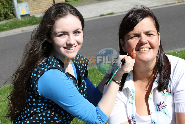 Martina Lennon gets her facepainted at the Family Fun Day in Betaghstown Wood....Photo NEWSFILE/Jenny Matthews.