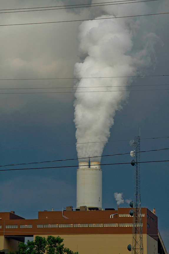 Smoke gushing from the smokestack of a coal plant.