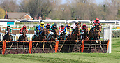 14h April 2018, Aintree Racecourse, Liverpool, England; The 2018 Grand National horse racing festival sponsored by Randox Health, day 3; Alan Johns (red) on Debece leads them over the hurdles in The Gaskells Handicap Hurdle