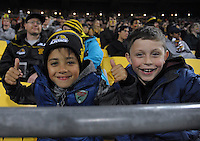 Fans in the grandstand during the Super Rugby match between the Hurricanes and Chiefs at Westpac Stadium, Wellington, New Zealand on Saturday, 23 April 2016. Photo: Dave Lintott / lintottphoto.co.nz
