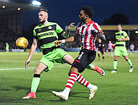 Lincoln City's Bruno Andrade vies for possession with Forest Green Rovers' Carl Winchester<br /> <br /> Photographer Andrew Vaughan/CameraSport<br /> <br /> The EFL Sky Bet League Two - Lincoln City v Forest Green Rovers - Saturday 3rd November 2018 - Sincil Bank - Lincoln<br /> <br /> World Copyright &copy; 2018 CameraSport. All rights reserved. 43 Linden Ave. Countesthorpe. Leicester. England. LE8 5PG - Tel: +44 (0) 116 277 4147 - admin@camerasport.com - www.camerasport.com