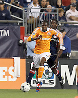 Second half substitute Houston Dynamo midfielder Macoumba Kandji (9) on the attack as New England Revolution midfielder Shalrie Joseph (21) closes. In a Major League Soccer (MLS) match, the New England Revolution tied Houston Dynamo, 2-2, at Gillette Stadium on May 19, 2012.