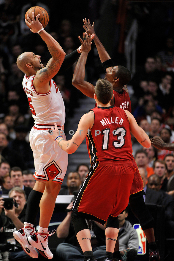CARLOS BOOZER, of the Chicago Bulls , in actions during the Bulls game against the Miami Heat at the United Center on January 15, 2011.  The Bulls won the game beating the Heat 99-96