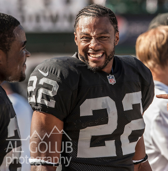 Oakland Raiders running back Taiwan Jones (22) happy on the sidelines on Sunday, September 23, 2012, in Oakland, California. The Raiders defeated the Steelers 34-31.  .