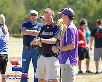 Southern Illinois University Coach Matt Sparks talks with Eureka's Brad Demattei at the 2013 Forest Park Cross Country Festival.