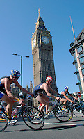 03 AUG 2003 -  LONDON, UK - .Elite men make the turn in front of the Houses of Parliament during the 2003 London Triathlon. (PHOTO (C) NIGEL FARROW)