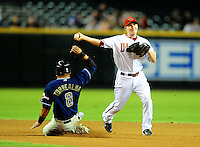Aug. 30, 2010; Phoenix, AZ, USA; Arizona Diamondbacks shortstop Stephen Drew (right) throws to first base for the double play after forcing out San Diego Padres baserunner Yorvit Torrealba at Chase Field. Mandatory Credit: Mark J. Rebilas-