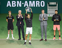 Rotterdam, The Netherlands, 18 Februari, 2018, ABNAMRO World Tennis Tournament, Ahoy, Singles final, Winner Roger Federer (SUI) with the trophy, next to tournament director Richard Krajicek the runner up Grigor Dimitrov, left CEO of the ABNAMRO Bank Kees van Dijkhuizen<br /> <br /> Photo: www.tennisimages.com