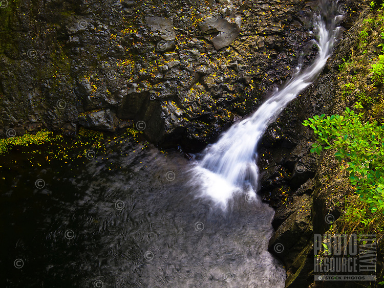 A birds' eye view of a small waterfall along the Pipiwai Trail in the Haleakala National Park, Maui.
