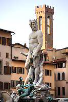 General view of Neptune Fountain, 1563-65, by Ammannati, Piazza della Signoria, Florence, Tuscany, Italy, pictured on June 9, 2007, in the afternoon with the Palazzo Vecchio tower in the background. The Fountain of Neptune by Bartolomeo Ammannati (1511-92) was commissioned for the wedding of Francesco I de' Medici in 1565. The nymphs and satyrs were carved by Giambologna (1529-1608). The figure of Neptune is a 19th century copy whose original is in the National Museum. Florence, capital of Tuscany, is world famous for its Renaissance art and architecture. Its historical centre was declared a UNESCO World Heritage Site in 1982. Picture by Manuel Cohen.
