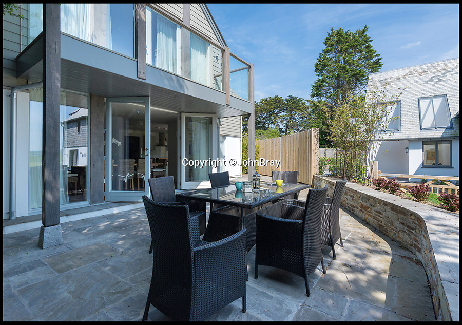 BNPS.co.uk (01202)558833<br /> Pic:  JohnBray/BNPS<br /> <br /> A stunning new-build beach retreat next door to Gordon Ramsay's controversial property project is on the market for £1.95m.<br /> <br /> Tregye is in the heart of the celebrity seaside hotspot of Rock, Cornwall, and has direct access to the beach and water.<br /> <br /> On the plot next door TV chef and restaurateur Ramsay has demolished a 1920s property and is replacing it with two luxury homes.<br /> <br /> The four-bedroom new-build house is now on the market with estate agents John Bray, who say it is the perfect holiday home.