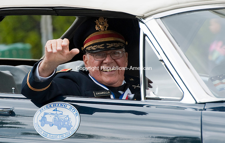 WATERBURY, CT 26 MAY 2013--052613JS02- Col. John Chiarella, Chairman of the Waterbury Veterans Memorial Committee, wave to the crowds as he rides in the annual Waterbury Memorial Day parade on Sunday. .Jim Shannon Republican American
