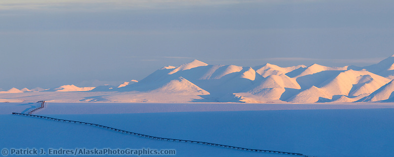 Trans Alaska Oil Pipeline traverses the snow covered Arctic Coastal Plains of Alaska, Philip Smith Mountains of the Brooks range.