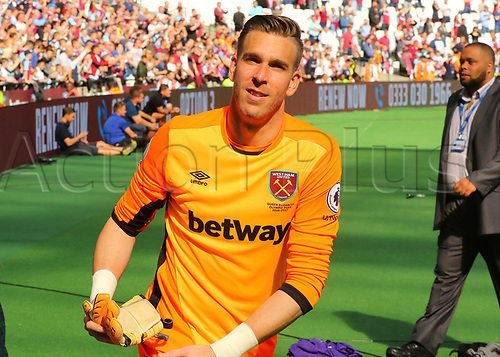May 14th 2017, London Stadium, London, England; EPL Premier League football, West Ham United versus Liverpool; West Ham Goalkeeper Adrian gives his gloves to fans at full time