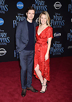 LOS ANGELES, CA - NOVEMBER 29: Topher Grace (L) and Ashley Hinshaw attend the Premiere Of Disney's 'Mary Poppins Returns' at El Capitan Theatre on November 29, 2018 in Los Angeles, California.<br /> CAP/ROT/TM<br /> &copy;TM/ROT/Capital Pictures