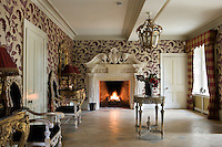 This grand entrance hall is dominated by a large carved stone fireplace