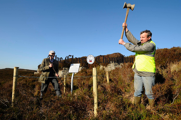 Michael Moloney and Michael Minogue working on the signage for the 400 million year old rock as part of the Feakle Rural Social Scheme on top of Ballycroum mountain in Feakle. Photograph by John Kelly.